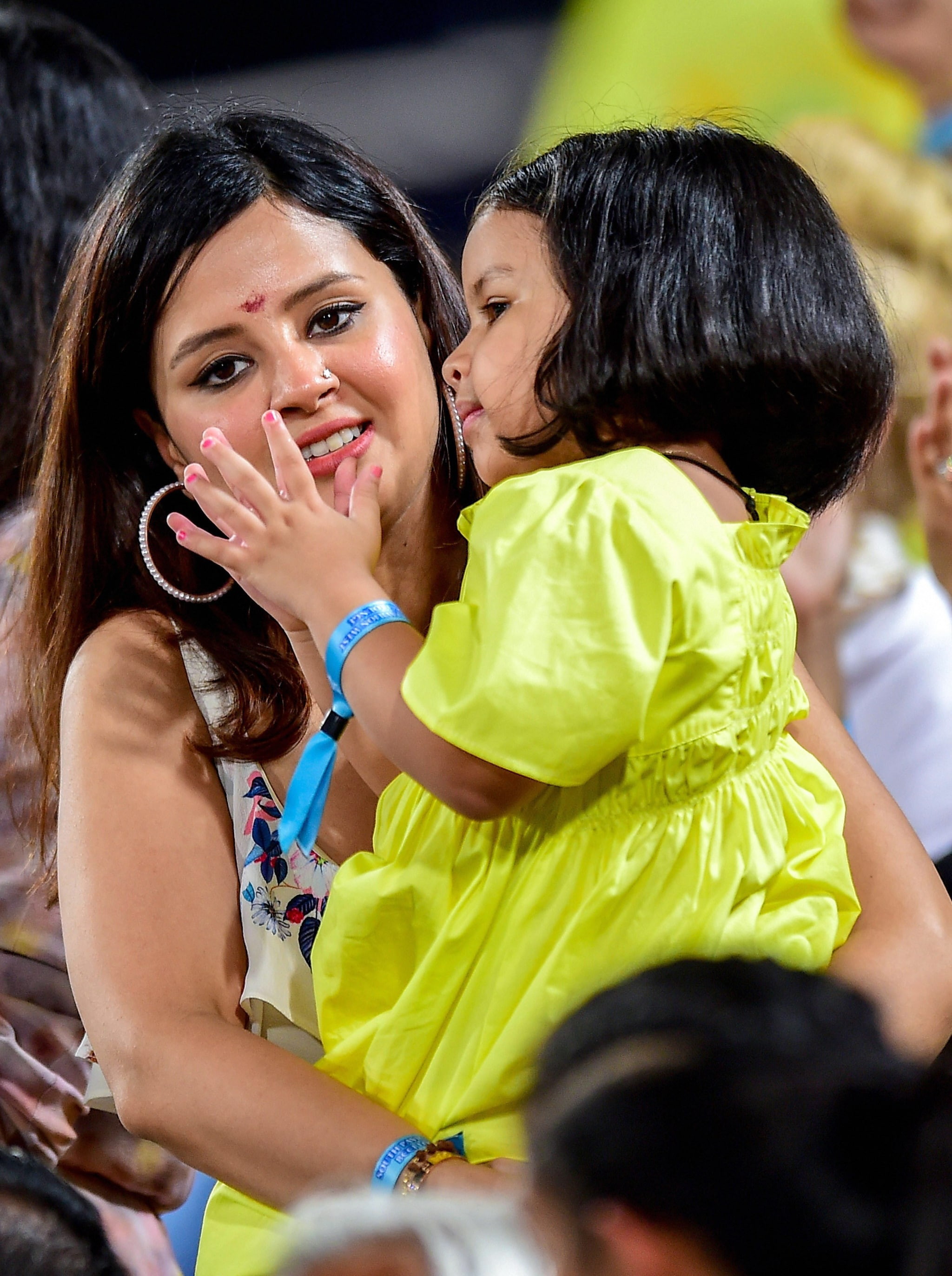 Sakshi Dhoni, wife of CSK skipper MS Dhoni, with daughter Ziva during the Indian Premier League 2019 final cricket match | PTI