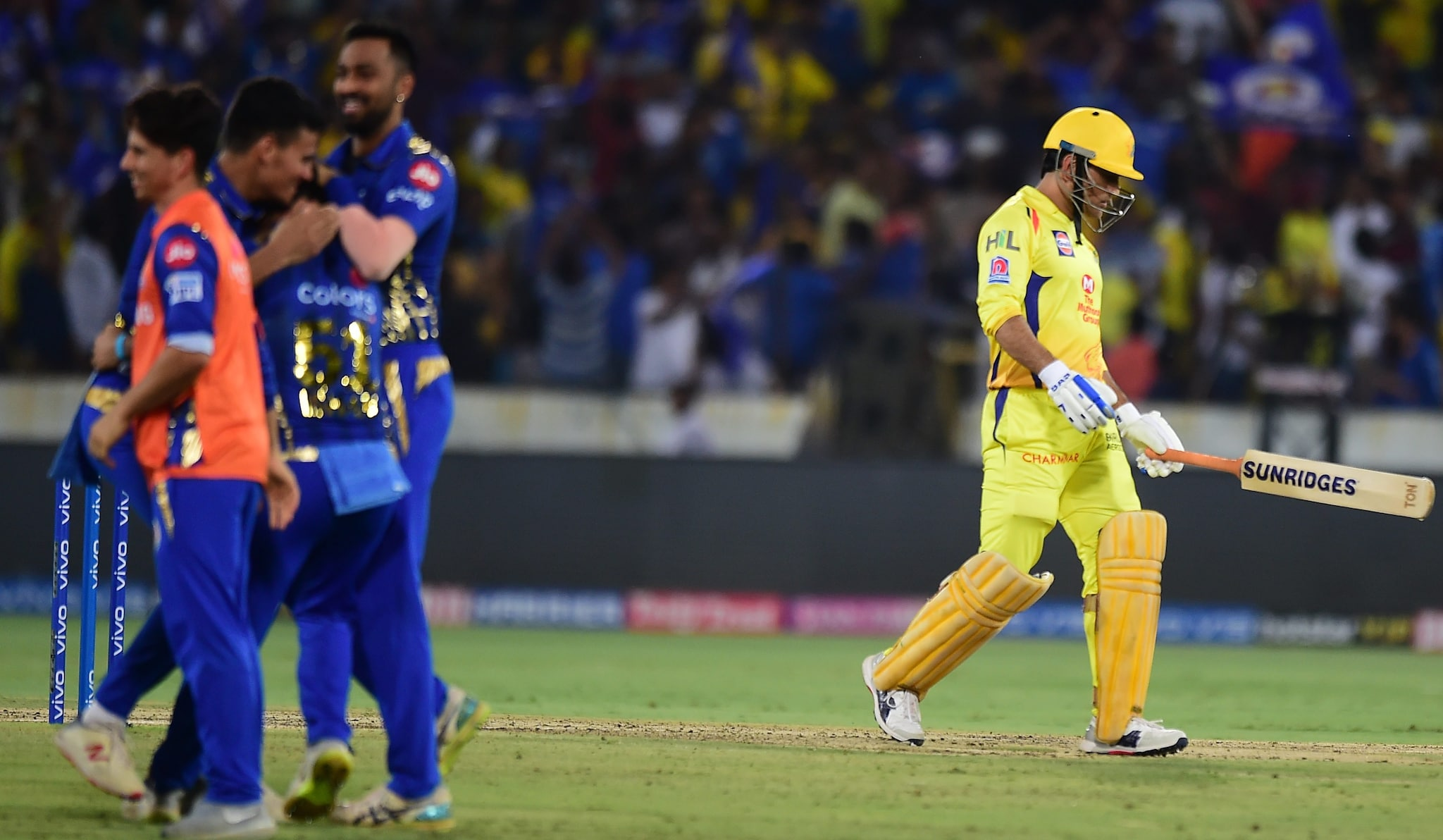 Mumbai Indians (MI) player Ishan Kishan celebrating with teammates for the run out of Chennai Super Kings (CSK) skipper MS Dhoni | PTI