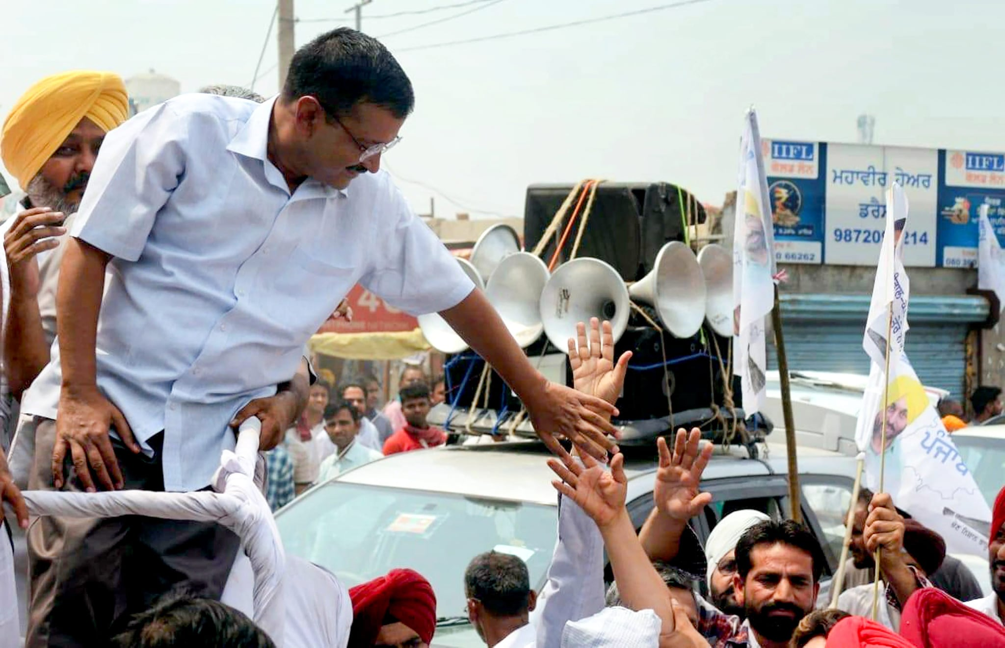 Sangrur: Delhi Chief Minister and AAP convener Arvind Kejriwal during an election campaign roadshow for the seventh and last phase of Lok Sabha polls, in Sangrur, Punjab, Monday, May 13, 2019. (PTI Photo)  (PTI5_13_2019_000141B)