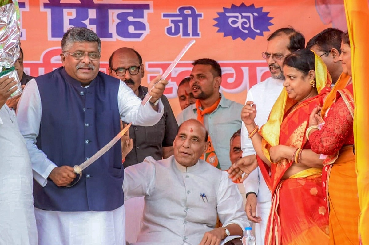 Senior BJP leader Rajnath Singh with BJP candidate from Patna Sahib Ravi Shankar Prasad during an election rally for Lok Sabha polls, at Bakhtiyarpura in Patna. (PTI Photo)