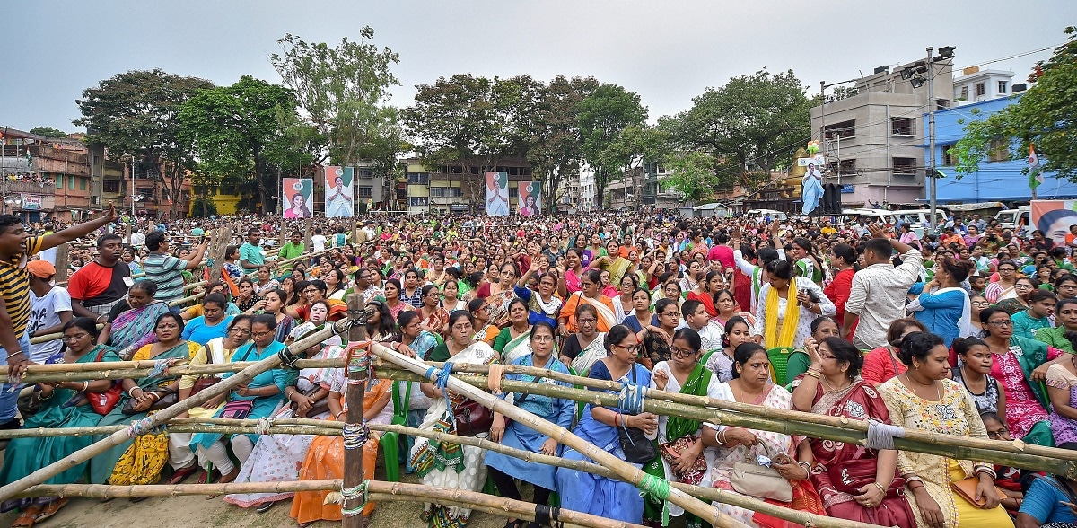 Trinamool Congress supporters gather during an election rally by West Bengal Chief Minister and party supremo Mamata Banerjee for the last phase of Lok Sabha polls, in Kolkata. (PTI Photo/Swapan Mahapatra)