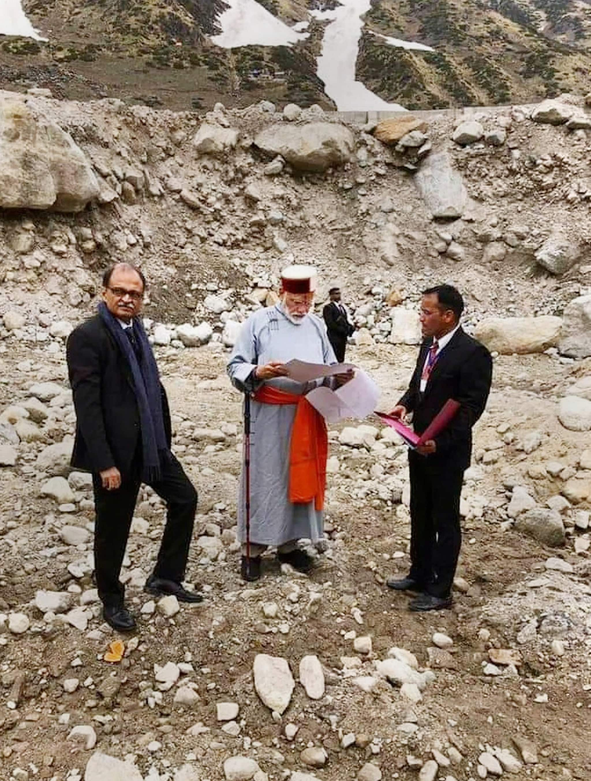 Kedarnath: Prime Minister Narendra Modi inspects reconstruction work on his arrival at Kedarnath, for this two day pilgrimage to Himalayan shrines, in Rudraprayag district, Saturday, May 18, 2019. PM Modi will visit Badrinath on Sunday. (PTI Photo)(PTI5_18_2019_000037B)