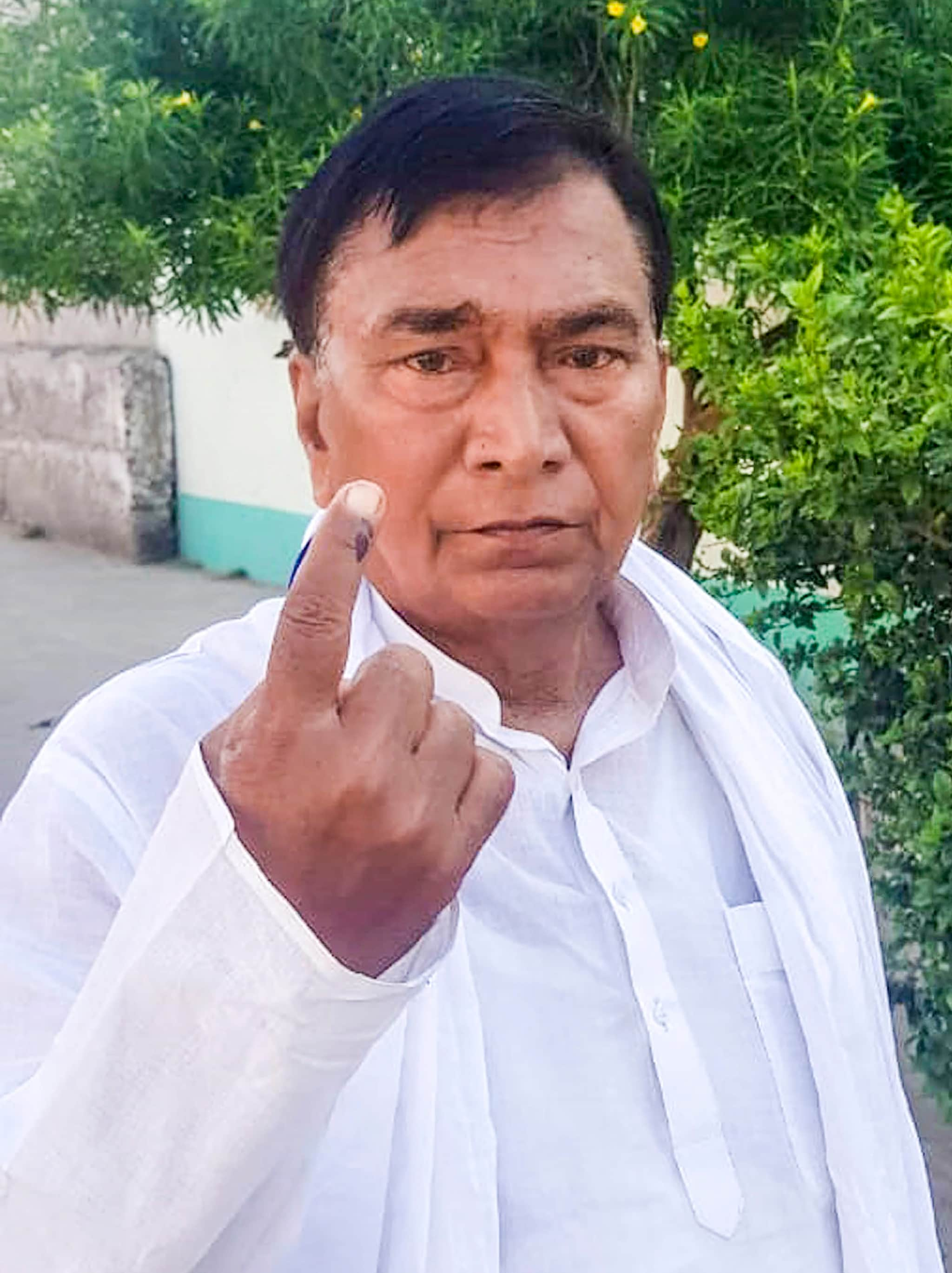 Bihar's Education Minister, Krishnanand Verma, shows his finger marked with indelible ink after casting vote at a polling station during the seventh phase of Lok Sabha elections, in Jahanabad district, Sunday, May 19, 2019. (PTI Photo)