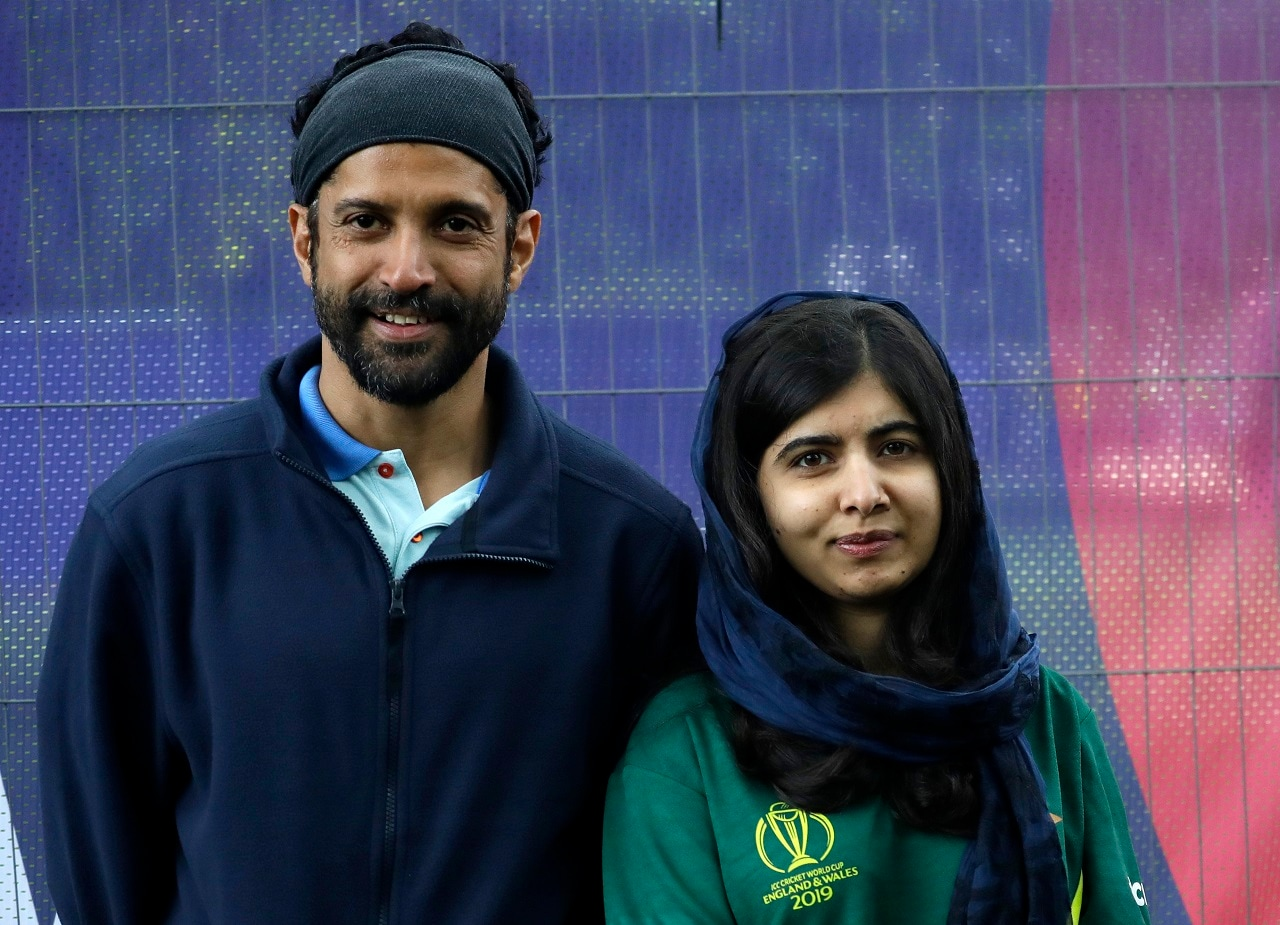 London: Malala Yousafzai, Pakistani Nobel Peace Prize winner, poses for a photograph with Farhan Akhtar, Indian Film Director, during a media opportunity to speak to cricket legends and celebrities from each of the competing nation ahead of the Cricket World Cup opening party along The Mall in London, Wednesday, May 29, 2019. The opening Cricket World Cup match takes place on Thursday at The Oval in London. AP/PTI Photo(AP5_29_2019_000165B)