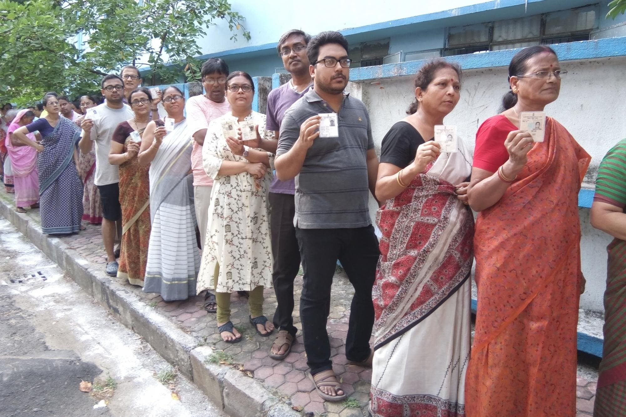 People queue-up to cast their votes during the seventh and the last phase of 2019 Lok Sabha Elections at a polling booth in Barasat, near Kolkata on May 19, 2019. (Photo: IANS)
