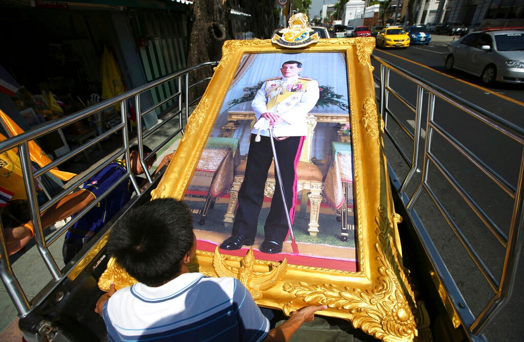 Thai workers prepare to transport a giant portrait of Thailand's King Maha Vajiralongkorn by truck to a buyer's house in Bangkok, Thailand, Monday, April 29, 2019. (AP Photo/Sakchai Lalit)