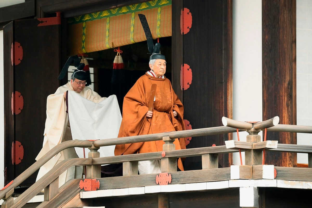 Japan's Emperor Akihito, right, leaves after a ritual to report his abdication to the throne, at the Imperial Palace in Tokyo. The 85-year-old Akihito ends his three-decade reign on Tuesday when he abdicates to his son Crown Prince Naruhito. (Japan Pool via AP)