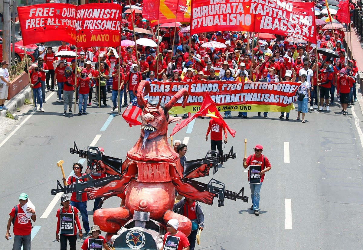Workers march with an effigy of President Rodrigo Duterte towards the Presidential Palace in Manila, Philippines, to pay tribute to workers in celebration of International Labor Day. (AP Photo/Bullit Marquez)