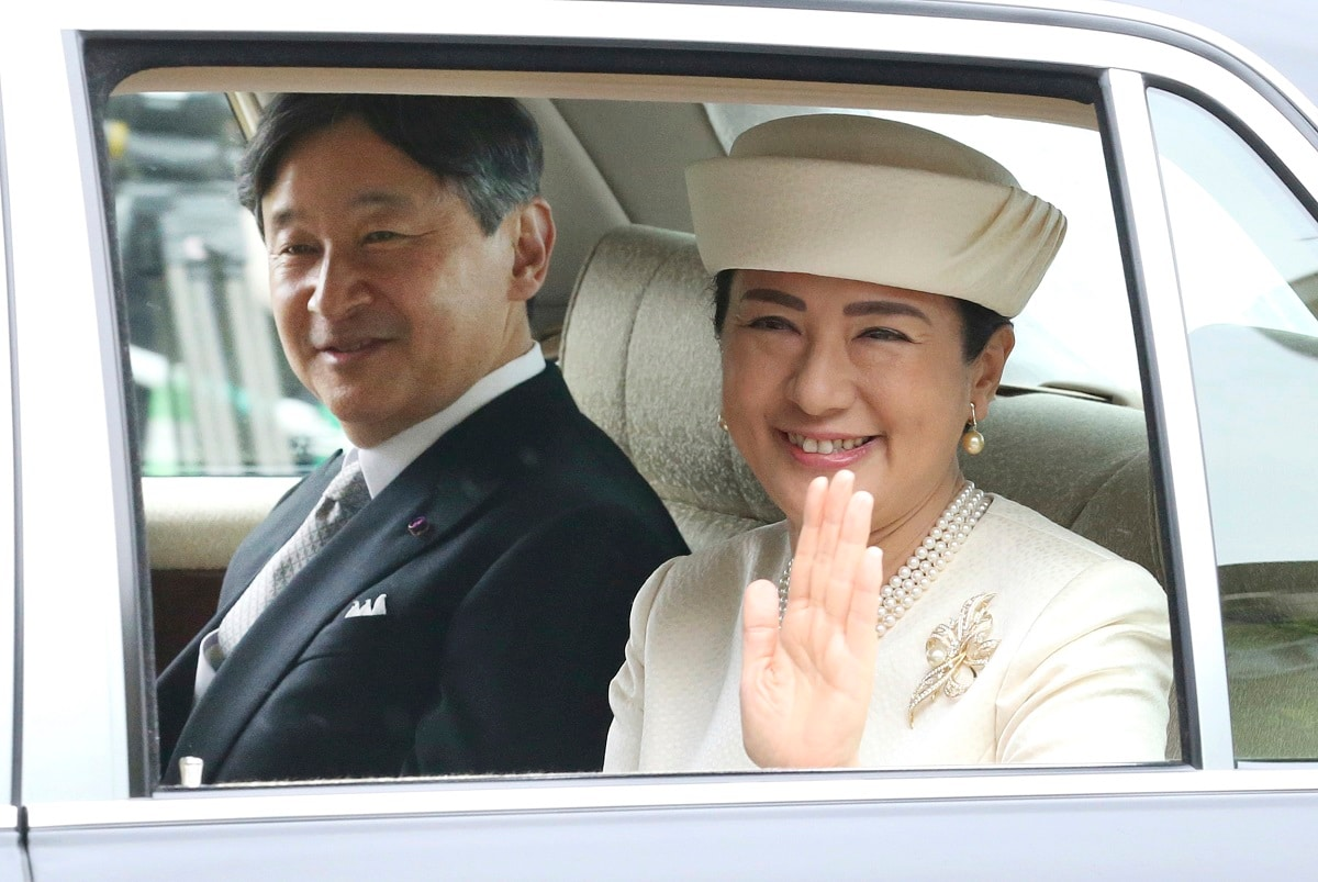 Japan's new Emperor Naruhito and new Empress Masako are driven to Imperial Palace to greet Emperor Emeritus Akihito and Empress Emerita Michiko in Tokyo. Naruhito succeeded to the Chrysanthemum Throne Wednesday after his father Akihito abdicated Tuesday. (AP Photo/Koji Sasahara)