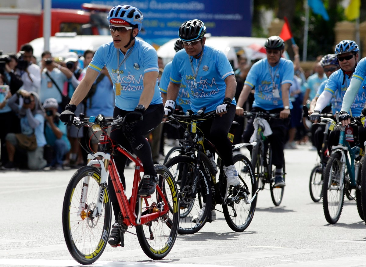 However Vajiralongkorn has started to make efforts to improve his reach to the people. He participated in two-high profile events in 2015, leading thousands of Thais in mass bicycling events to mark his parents' birthdays. (AP Photo/Sakchai Lalit, File)