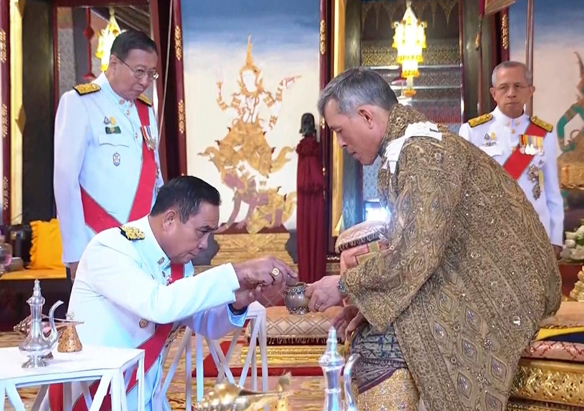 Thailand's King Maha Vajiralongkorn, right, attends the anointment ceremony at the Grand Palace. (Thai TV Pool via AP)