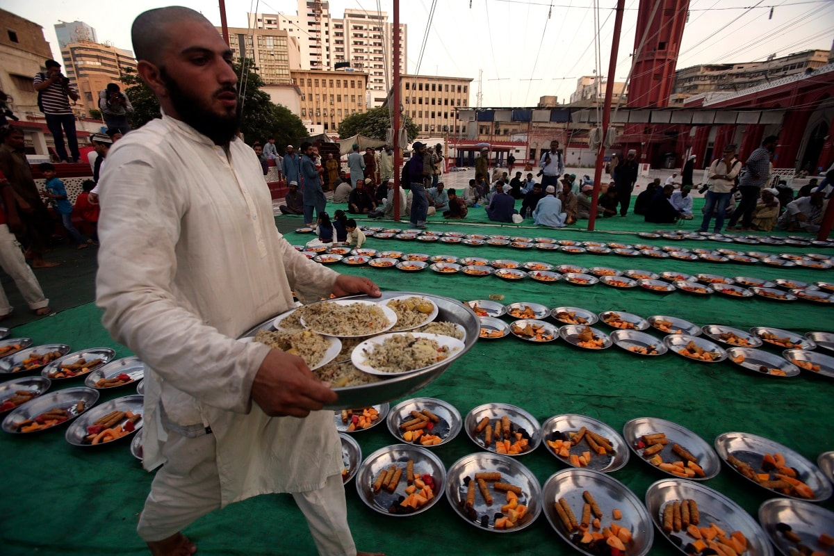 A volunteer arranges food for the