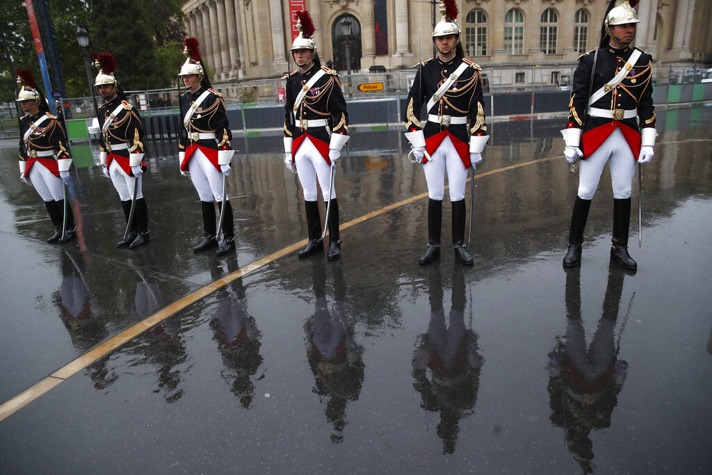 Republican Guards wait for French President Emmanuel Macron before a ceremony at the statue of General Charles de Gaulle to mark Victory Day in Paris, Wednesday, May 8, 2019. (AP Photo/Christophe Ena, Pool)
