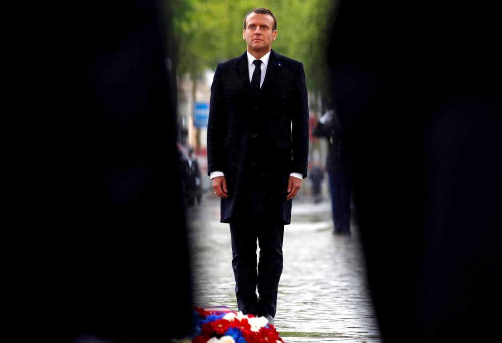 French President Emmanuel Macron attends a wreath-laying ceremony to mark the 74th anniversary of World War II victory in Europe, under the Arc de Triomphe Wednesday, May 8, 2019, in Paris. (Christian Hartmann, Pool via AP)