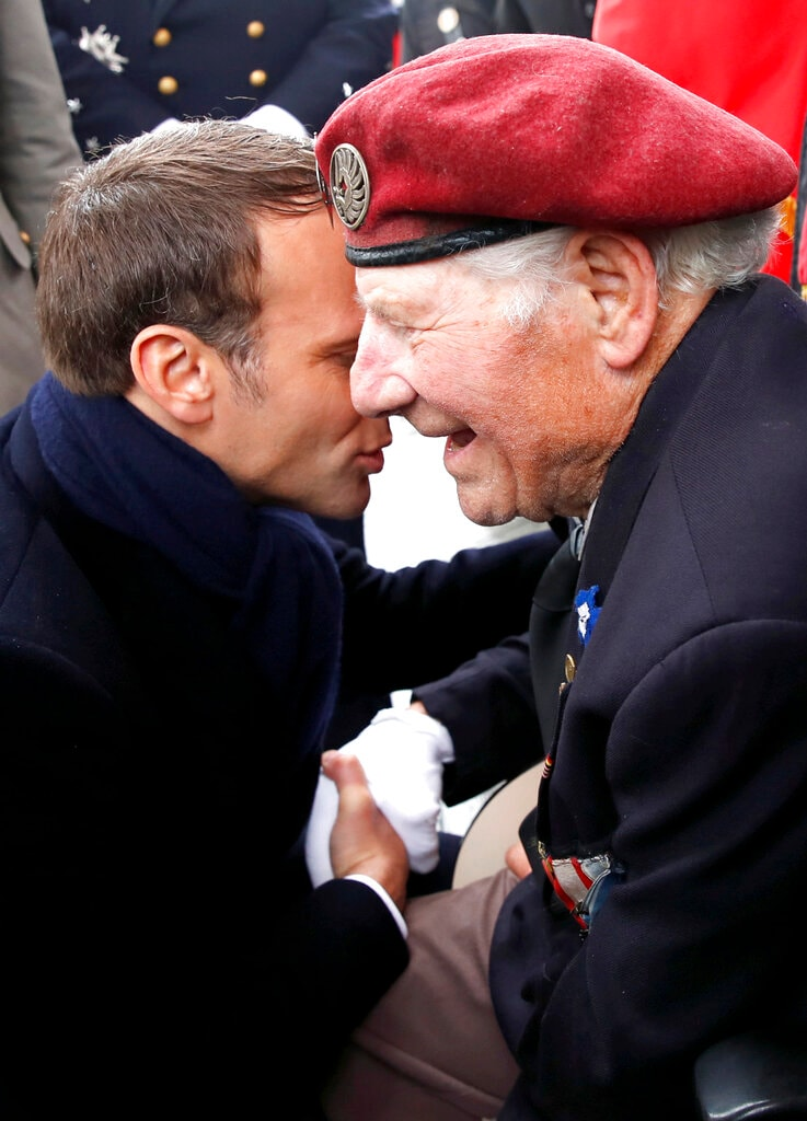 French President Emmanuel Macron greets a veteran during ceremonies marking the 74th anniversary of World War II victory in Europe, under the Arc de Triomphe Wednesday, May 8, 2019, in Paris. (Christian Hartmann, Pool via AP)
