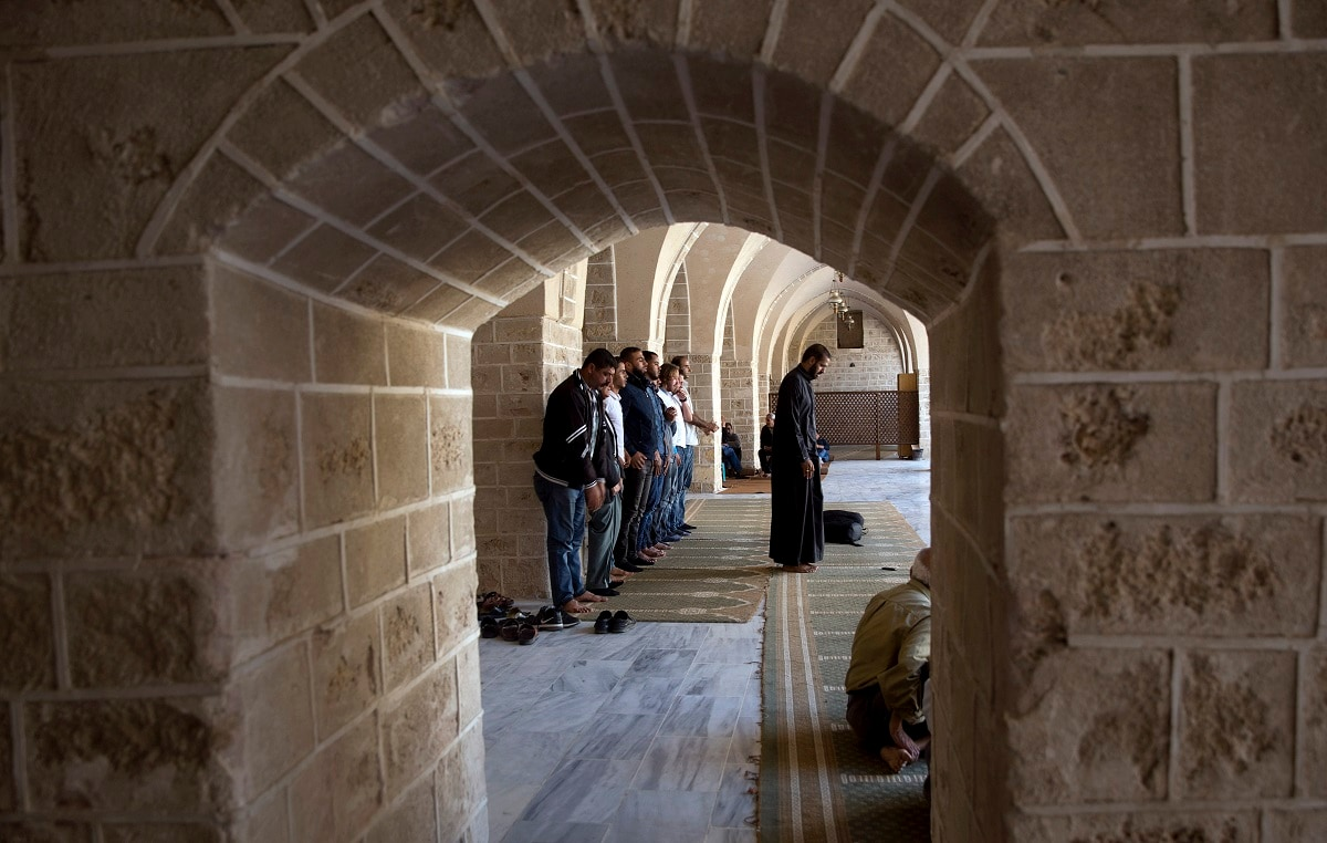 Palestinian Muslim worshipers pray at Al Emari mosque in Gaza City. (AP Photo/Hatem Moussa)