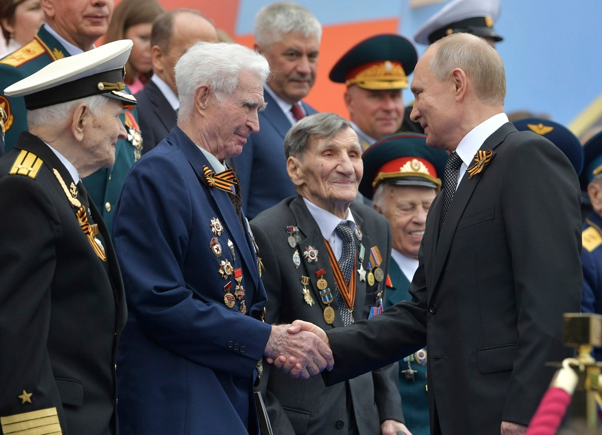 Russian President Vladimir Putin shakes hands with WWII veterans prior to a military parade marking 74 years since the victory in WWII in Red Square in Moscow. (Alexei Druzhinin, Sputnik, Kremlin Pool Photo via AP)
