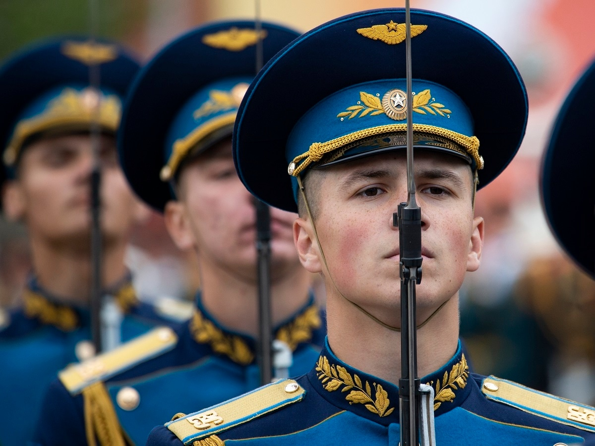 Russians stand during the Victory Day military parade to celebrate 74 years since the victory in WWII in Red Square in Moscow. Putin told the annual military Victory Day parade in Red Square that the country will continue to strengthen its armed forces. (AP Photo/Alexander Zemlianichenko)