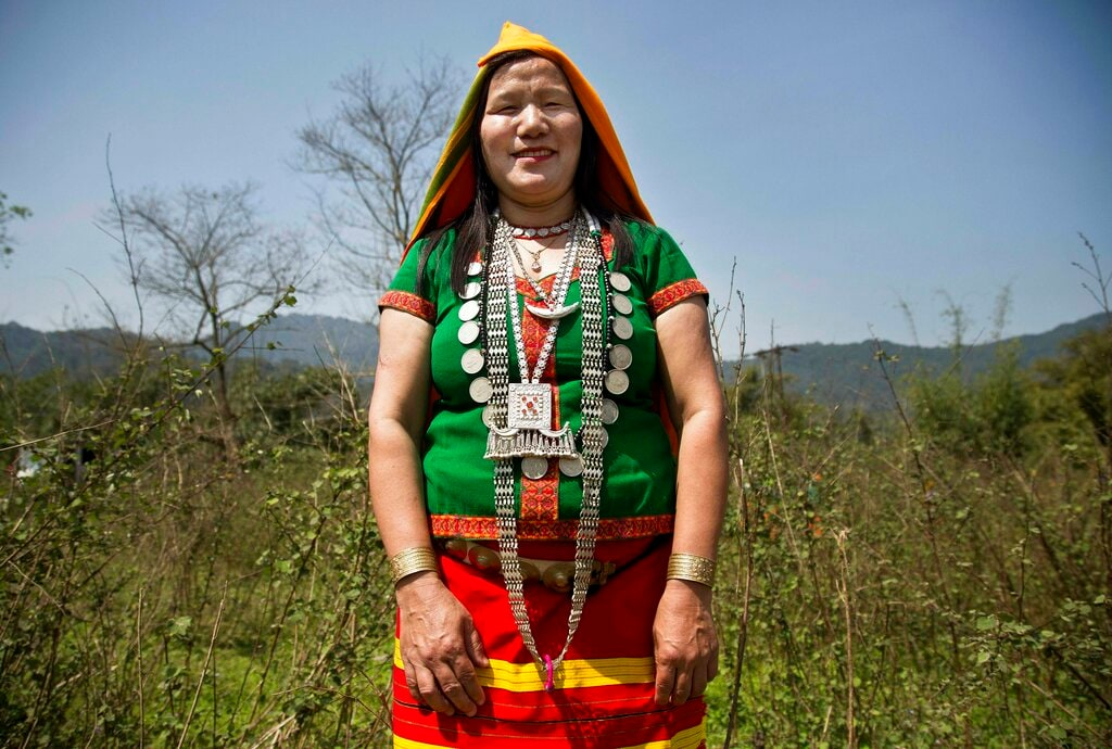 An Adi tribal woman Kargep Yao, 36, stands for a photograph in Along, Arunachal Pradesh. Yao said that she will cast her vote for a better future, development and security for women. March 30, 2019. (AP Photo/Anupam Nath)