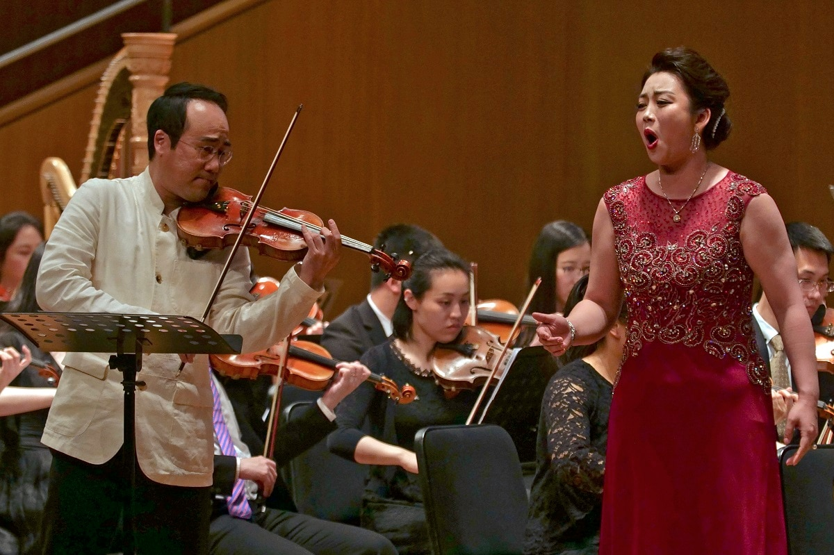 South Korean violinist Won Hyung Joon and his North Korean soprano partner Kim Song Mi perform at the Shanghai Oriental Arts Center in Shanghai. Won, a South Korean, performed together with Kim, a North Korean, in a rare joint performance they hope would help bring the divided Koreas closer together via music. Their performance comes three days after North Korea fired two suspected short-range missiles in the second such weapons test in five days. (AP Photo/Dake Kang, File)