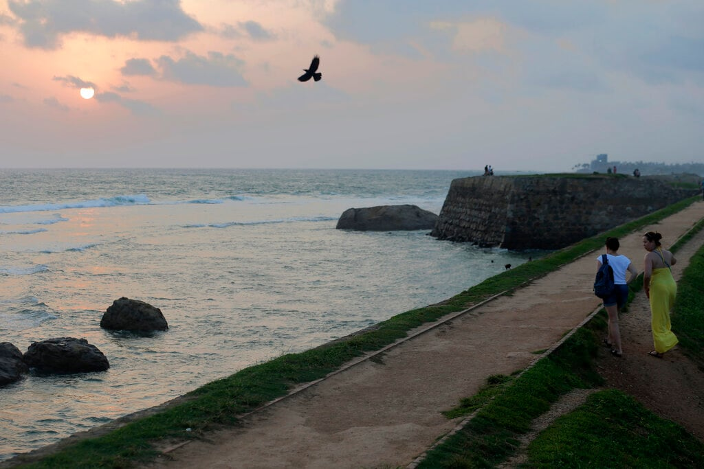 In this Friday, May 10, 2019, photo, foreign tourists walk on the rampart of the 17th century built Dutch fort in Galle, Sri Lanka. (AP)