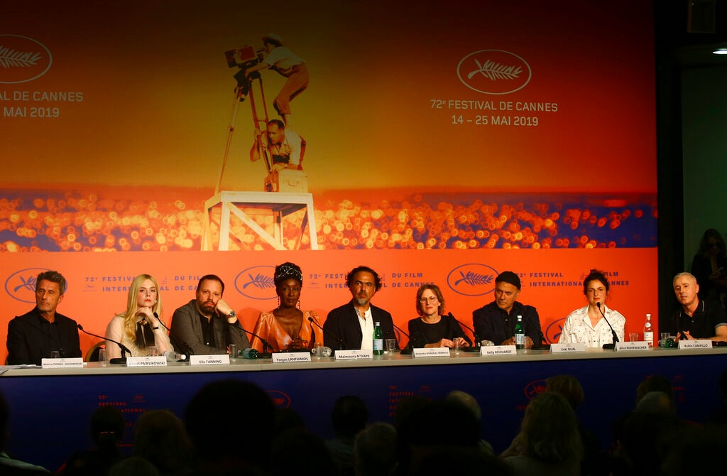 Jury members Pawel Pawlikowski, from left, Elle Fanning, Yorgos Lanthimos, Maimouna N'Diaye, jury president Alejandro Gonzalez Inarritu, jury members Kelly Reichardt, Enki Bilal, Alice Rohrwacher and Robin Campillo poses for photographers at the press conference for the jury at the 72nd international film festival, Cannes, southern France, Tuesday, May 14, 2019. (Photo by Joel C Ryan/Invision/AP)