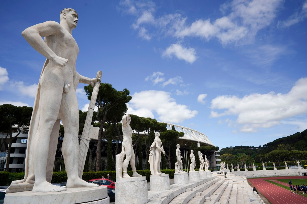 A marble statue holding a fasces, a bundle of rods tied together around an axe, adopted by Italian dictator Benito Mussolini as a symbol of power, adorns the track and field Stadio Dei Marmi stadium of the Foro Italico, in Rome. The Stadio Dei Marmi was designed by architect Enrico Del Debbio and completed in 1928. (AP Photo/Andrew Medichini)