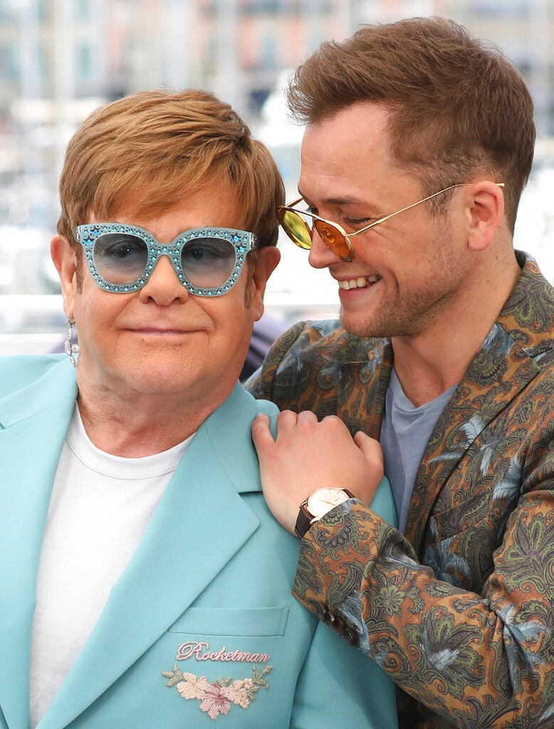 Actor Taron Egerton, right, and singer Elton John pose for photographers at the photo call for the film 'Rocketman' at the 72nd international film festival, Cannes, southern France, Thursday, May 16, 2019. (Photo by Vianney Le Caer/Invision/AP)
