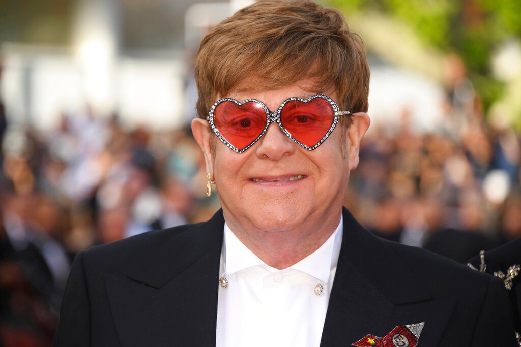 Singer Elton John poses for photographers upon arrival at the premiere of the film 'Rocketman' at the 72nd international film festival, Cannes, southern France, Thursday, May 16, 2019. (Photo by Arthur Mola/Invision/AP)
