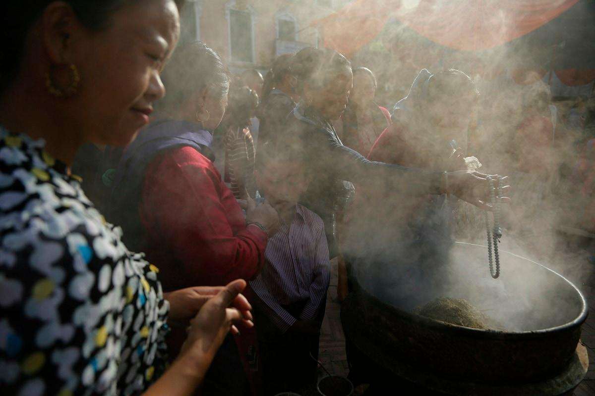Nepalese devotees light incense sticks during Buddha Jayanti, or Buddha Purnima in Kathmandu. (AP Photo/Niranjan Shrestha)