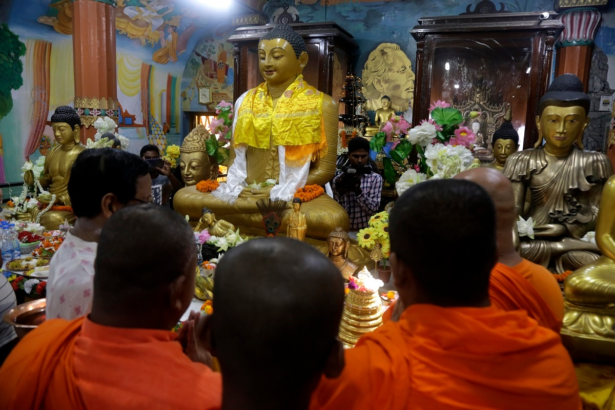 Buddhist monks and devotees offer prayers at a Buddhist temple during Buddha Purnima festival in Kolkata, India, Saturday, May 18, 2019. The festival marks the birth, enlightenment and death of Buddha. (AP Photo/Bikas Das)