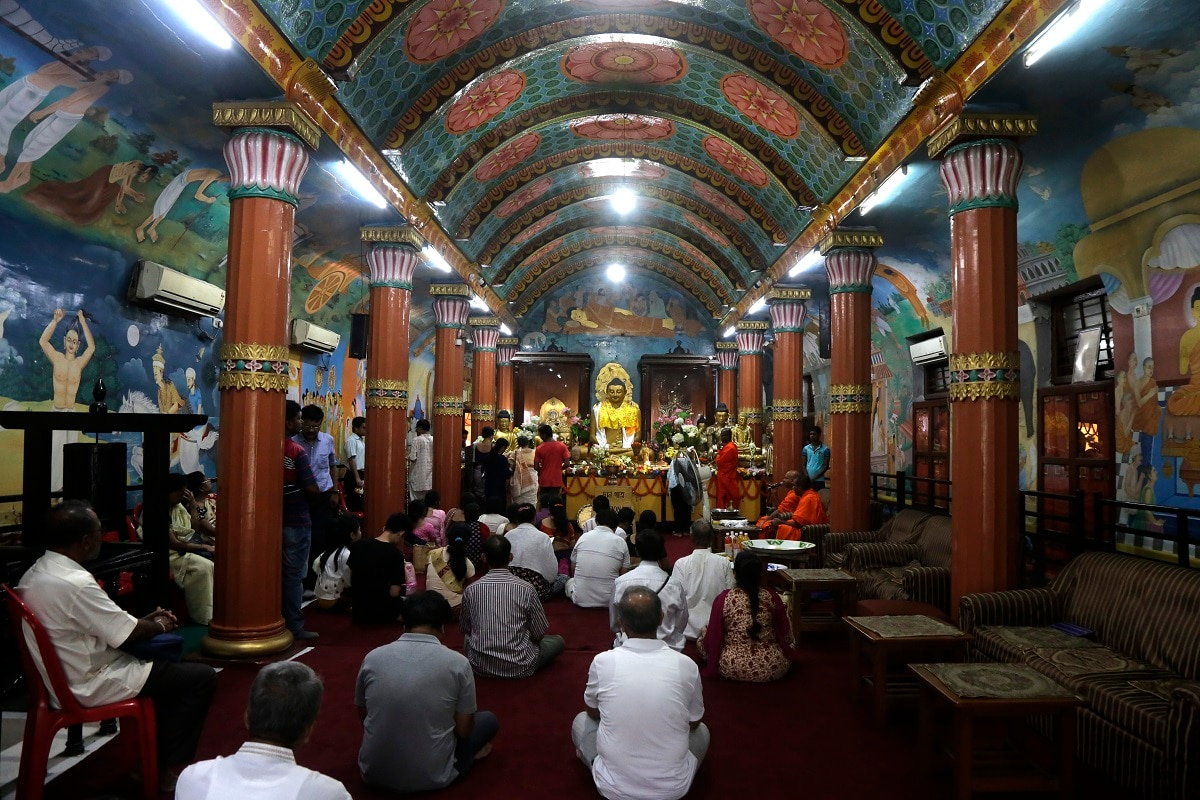 Devotees offer prayers at a Buddhist temple during Buddha Purnima festival in Kolkata, India, Saturday, May 18, 2019. The festival marks the birth, enlightenment and death of Buddha. (AP Photo/Bikas Das)