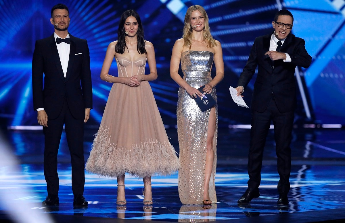 Eurovision hosts from left, Assi Azar, Lucy Ayoub, Bar Refaeli, and Erez Tal walk onto the stage for the start of the 2019 Eurovision Song Contest grand final in Tel Aviv, Israel. (AP Photo/Sebastian Scheiner)