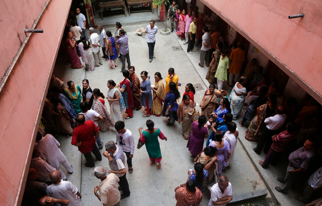 People line up to cast their votes outside a polling station during the final phase of national elections in Kolkata, India, Sunday, May 19, 2019. (AP Photo)