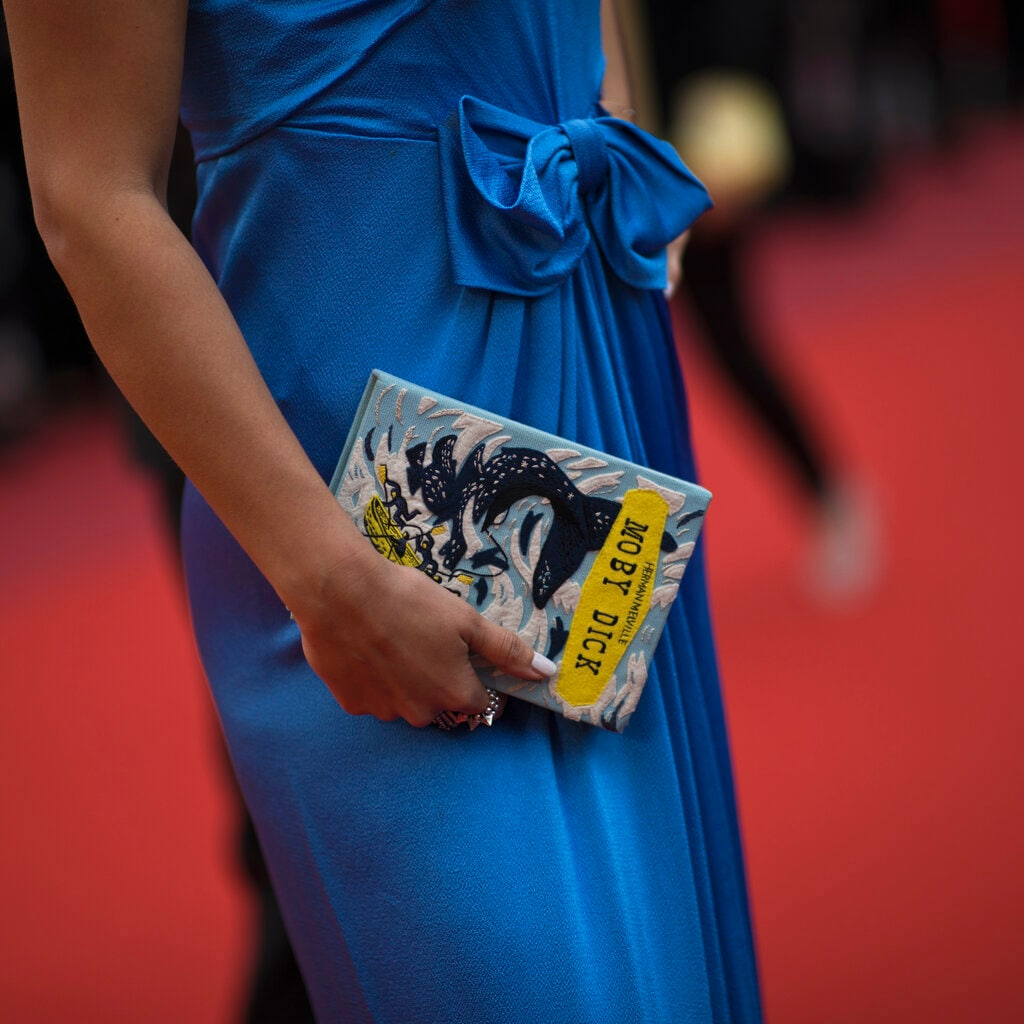 A woman poses for photographers upon her arrival at the premiere of the film 'A Hidden Life' at the 72nd international film festival, Cannes, southern France. (AP Photo/Petros Giannakouris)