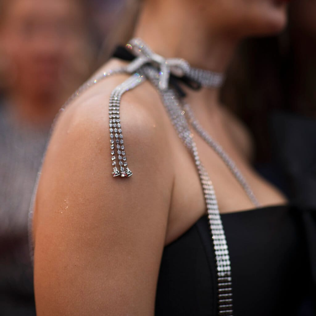 A woman poses for photographers upon her arrival for the premiere of the film 'A Hidden Life' at the 72nd international film festival, Cannes, southern France. (AP Photo/Petros Giannakouris)