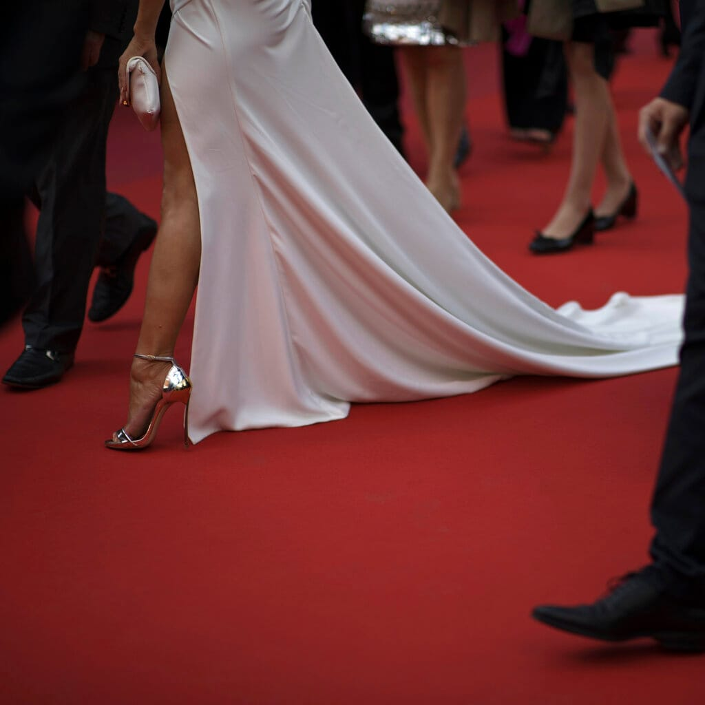 A woman walks along the red carpet for the premiere of the film 'Les Miserables' at the 72nd international film festival, Cannes, southern France. (AP Photo/Petros Giannakouris)