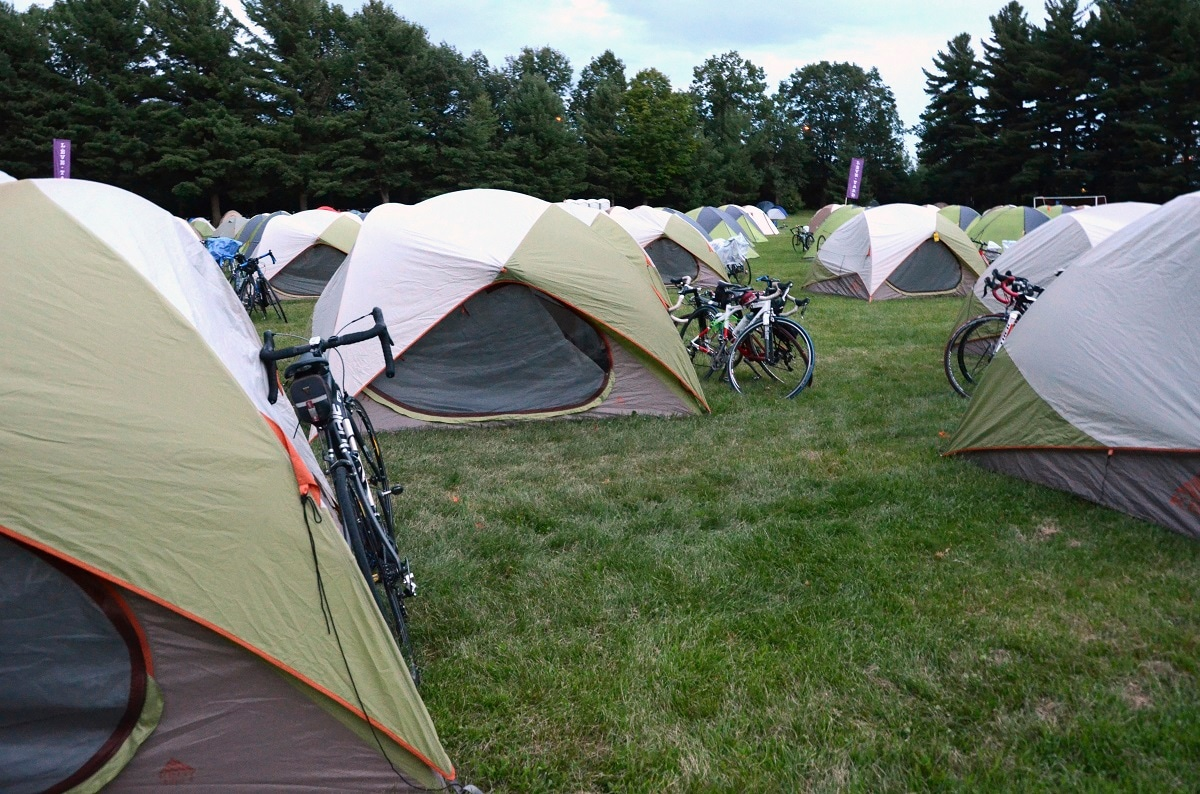 Tents await the cyclists on Velo Quebec's Grand Tour in Granby, Quebec. The tour is a logistical marvel, as transport trucks outfitted with showers move to each night's destination, support staff set up and break down the tents and Velo Quebec feeds the crowd, with massage available. (AP Photo, Cal Woodward)