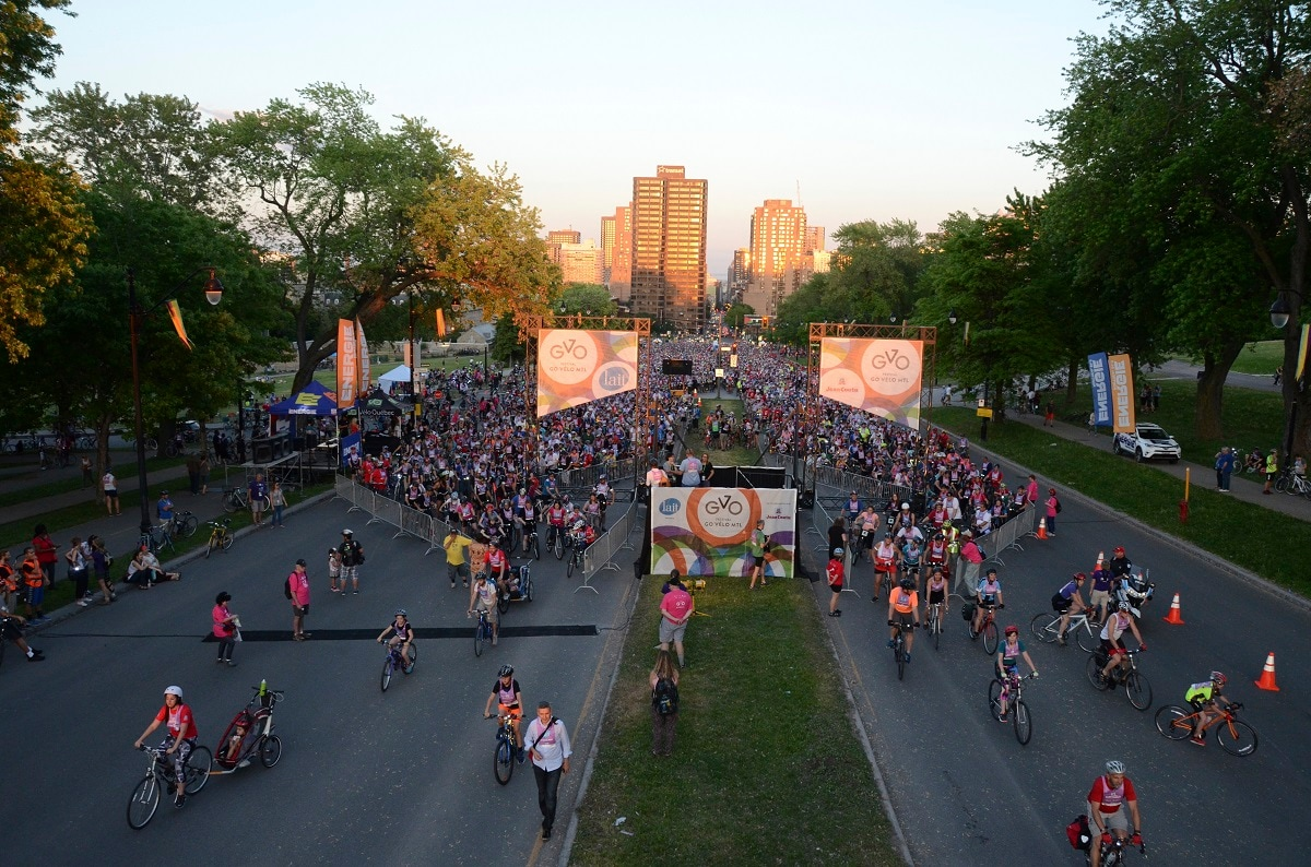 Cyclists get underway in Tour la Nuit, the annual Montreal bicycle festival's night ride, June 3, 2016. This year, on May 31, the crowd of some 10,000 will bicycle into and around Montreal's Olympic Stadium as part of the night tour. Montreal is a hotbed of cycling, with plentiful urban paths and access to long-distance touring routes and one of Canada's longest rail trails outside the city. (AP Photo/Cal Woodward)
