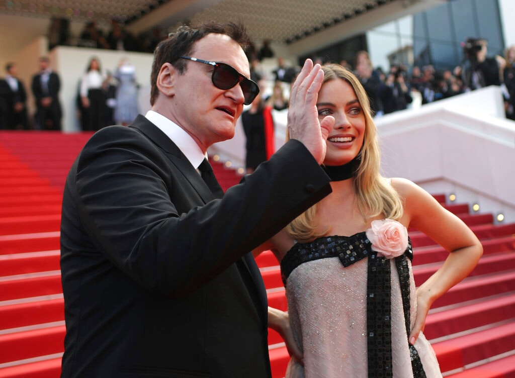 Director Quentin Tarantino, left, and Margot Robbie pose for photographers upon arrival at the premiere of the film 'Once Upon a Time in Hollywood' at the 72nd international film festival, Cannes, southern France, Tuesday, May 21, 2019. (AP Photo/Petros Giannakouris)