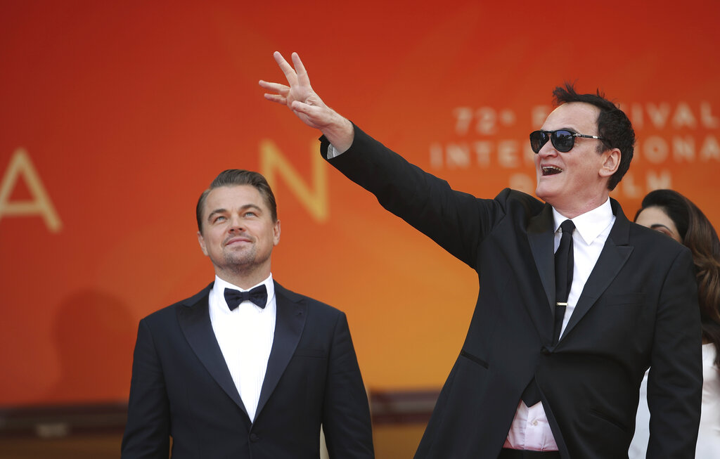 Actor Leonardo DiCaprio, left, and director Quentin Tarantino pose for photographers upon arrival at the premiere of the film 'Once Upon a Time in Hollywood' at the 72nd international film festival, Cannes, southern France, Tuesday, May 21, 2019. (AP Photo/Petros Giannakouris)
