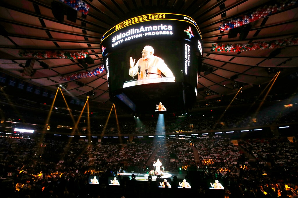 Prime Minister Narendra Modi gives a speech during a reception by the Indian community in honor of his visit to the United States at Madison Square Garden, in New York. Like President Donald Trump, to whom he is often compared, Modi is a big fan of Twitter, using it and a YouTube channel managed by the BJP to bypass traditional media. September 28, 2014. (AP Photo/Jason DeCrow, File)