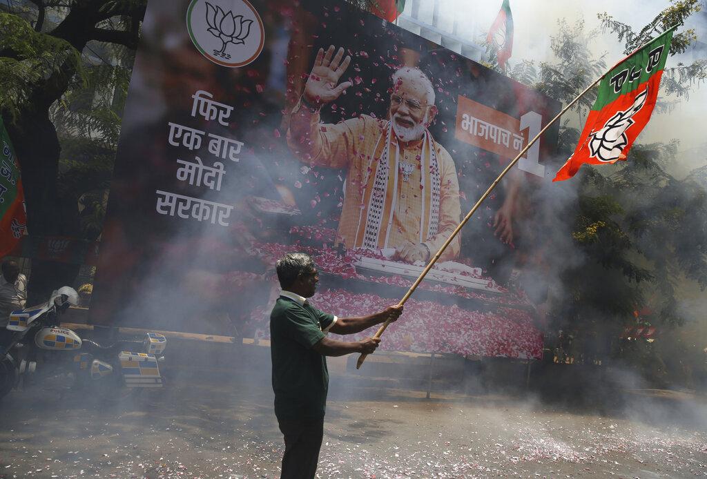 A Bharatiya Janata Party (BJP) workers celebrate outside BJP headquarters in Mumbai, India, Thursday, May 23, 2019. (AP Photo/Rafiq Maqbool)