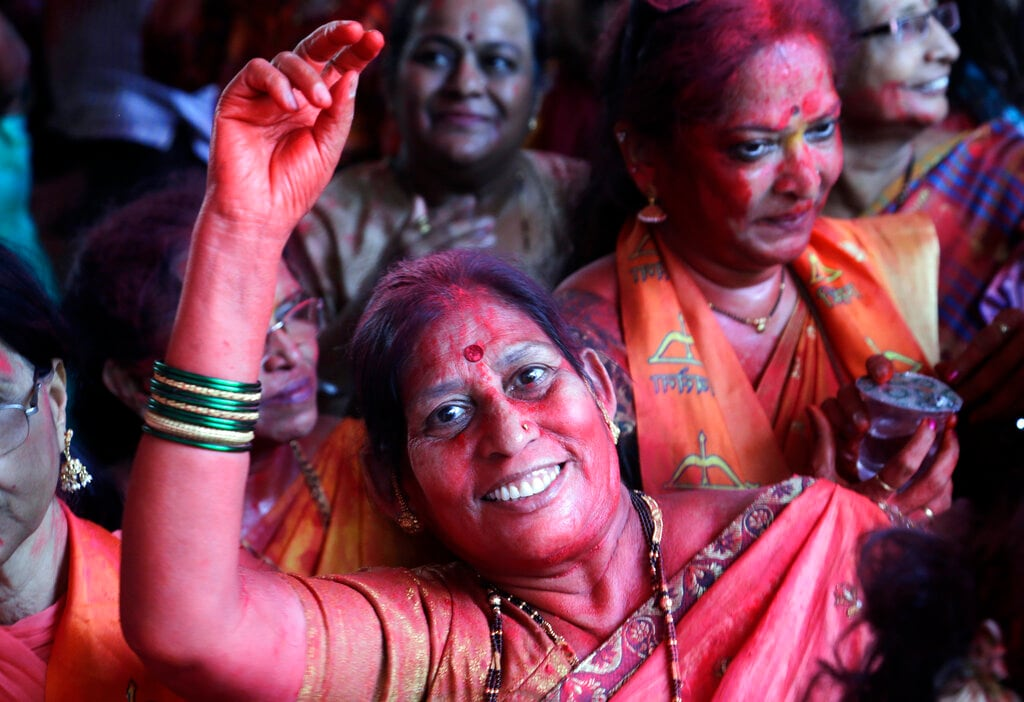 Party workers of Shiv Sena, an ally of Bharatiya Janata Party (BJP) celebrate outside party headquarters during counting of votes of general elections in Mumbai, India, Thursday, May 23, 2019. (AP Photo/Rajanish Kakade)