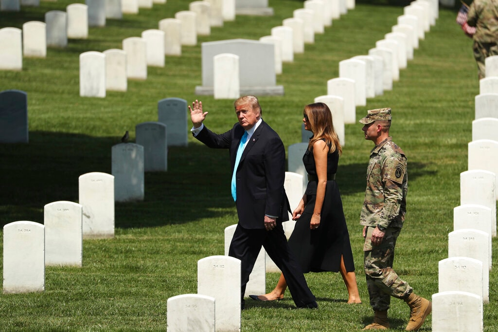 President Donald Trump and first lady Melania Trump visit Arlington National Cemetery for the annual Flags-In ceremony ahead of Memorial Day Thursday, May 23, 2019, in Arlington, Va. (AP Photo/Andrew Harnik)