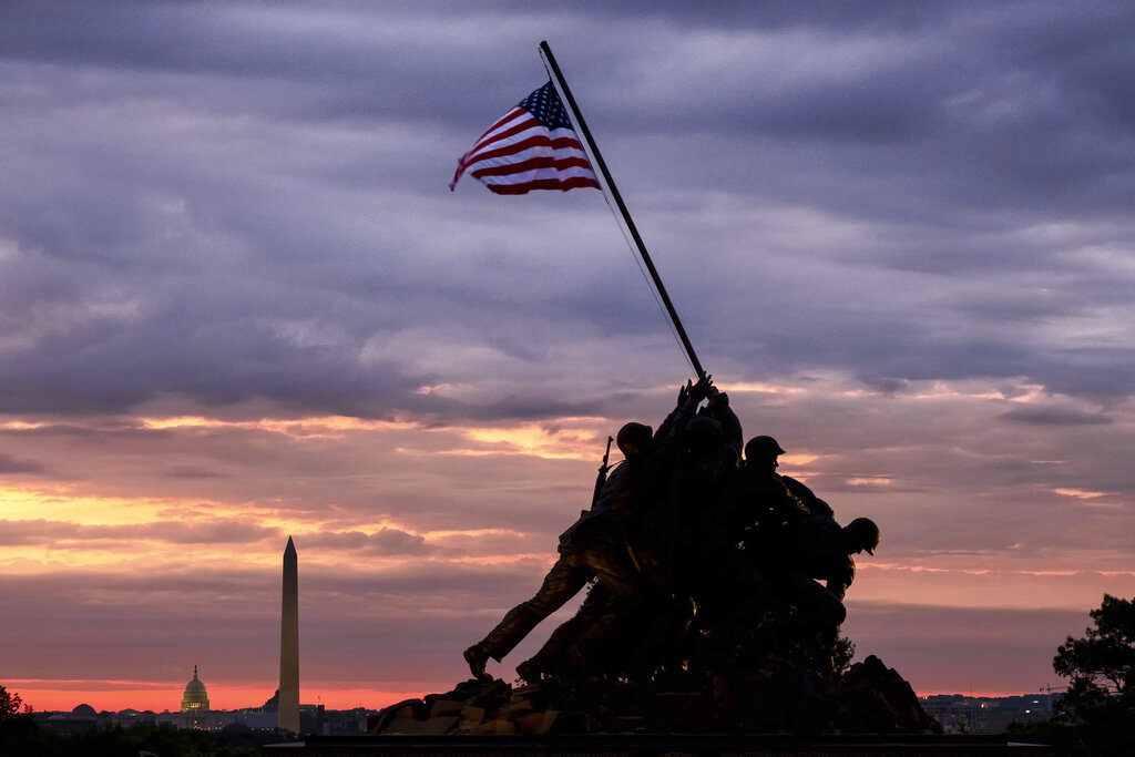 The US Marine Corps War Memorial in Arlington, Va. is silhouetted against daybreak in the Washington, DC area Saturday morning May 25, 2019, at the outset of the Memorial Day weekend holiday. (AP Photo/J. David Ake)