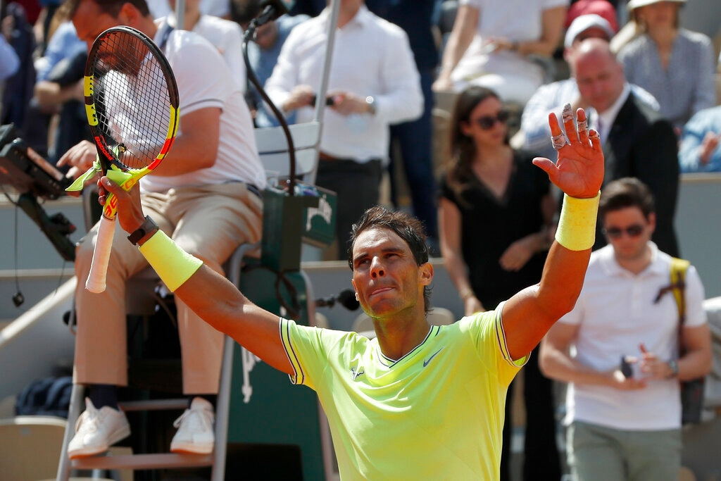 Spain's Rafael Nadal celebrates winning against Germany's Yannick Hanfmann in three sets 6-2, 6-1, 6-3, during their first round match of the French Open tennis tournament at the Roland Garros stadium in Paris, Monday, May 27, 2019. (AP Photo/Pavel Golovkin)