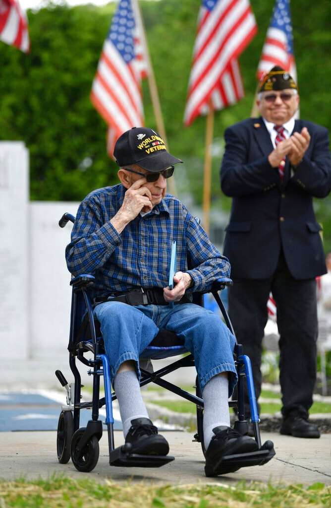 World War II US Army veteran Urban Link, 92, wipes away a tear after receiving his high school diploma during a Memorial Day ceremony in Hastings, Pa., Monday, May 27, 2019. Link left the former Hastings High School in his junior year to join the war effort, serving in Okinawa, Japan. The diploma was from Cambria Heights High School, which replaced the former Hastings High School. (John Rucosky/The Tribune-Democrat via AP)
