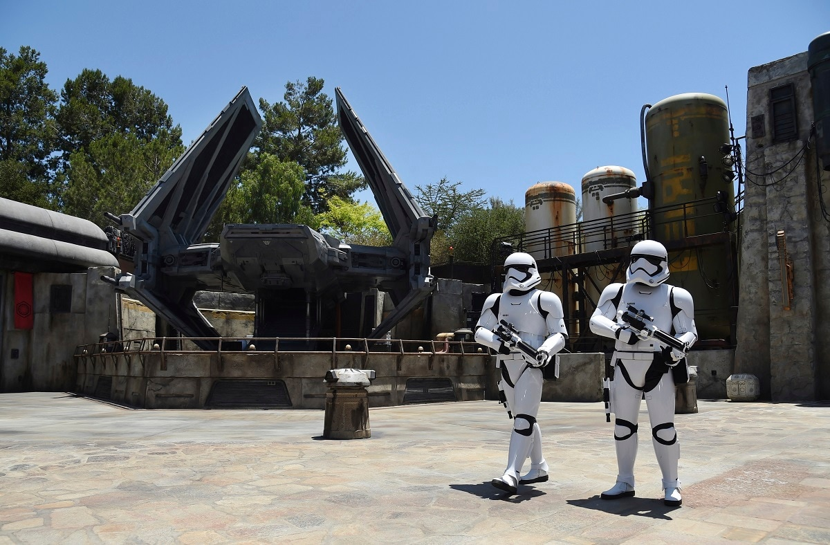 Stormtroopers patrol the Tie Echelon Stage during the Star Wars: Galaxy's Edge Media Preview at Disneyland Park in Anaheim, California. Galaxy's Edge opens at the California theme park on Friday.That's when guests with a pre-reservation can experiencethe largest single-themed land created in a Disney park. (Photo by Chris Pizzello/Invision/AP)
