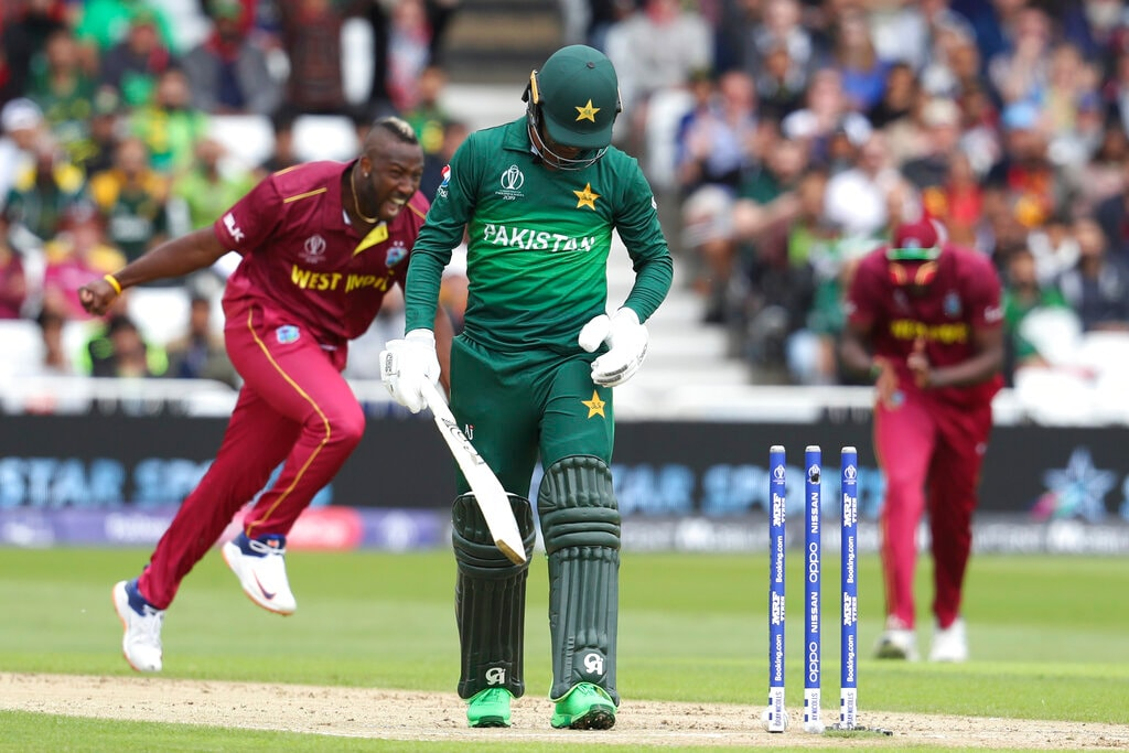 Pakistan's Shadab Khan walks off the field, bowled by West Indies' Andre Russell, during their Cricket World Cup match at Trent Bridge cricket ground in Nottingham, England, Friday, May 31, 2019. (AP Photo/Rui Vieira)